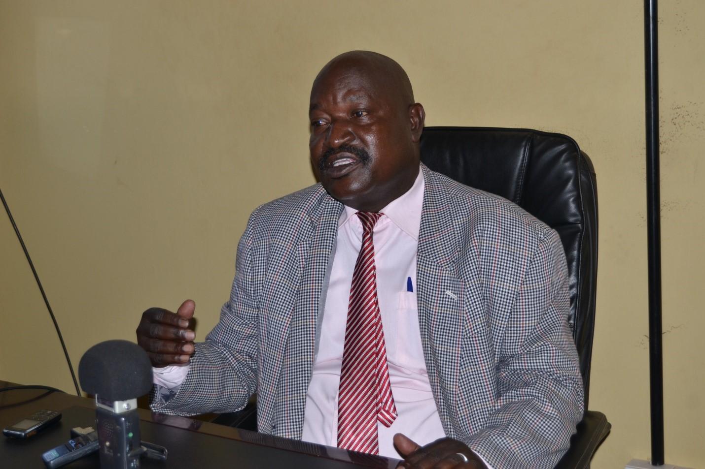 Dr. Sam Mutiti Tumwesige addressing the media